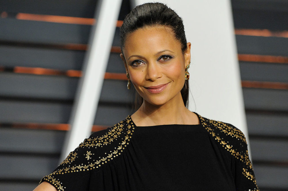 Thandie Newton wears a multi-colored, sequined, puffy sleeved dress that takes the gumption of Maeve to pull off flawlessly