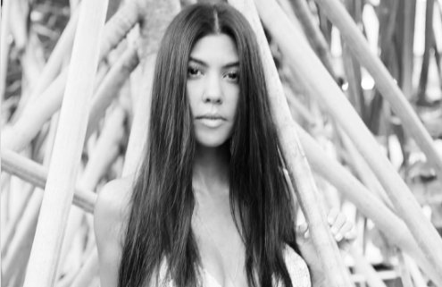 Kourtney Kardashian wore the cutest white bikini on vacation, proving that stars don't have to deal with winter