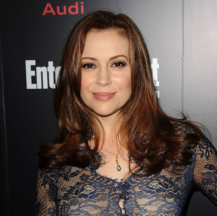 Alyssa Milano's patterned blue and nude dress looks risqué at first glance