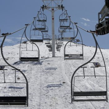 This skier nearly hit a chairlift while performing a double back flip on the slopes