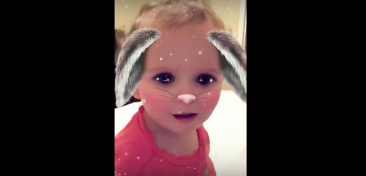 This toddler stopped crying when she caught a glimpse of her fabulous self in the Snapchat bunny filter