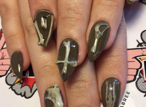 These nails created with actual bones are something Morticia Addams would kill for
