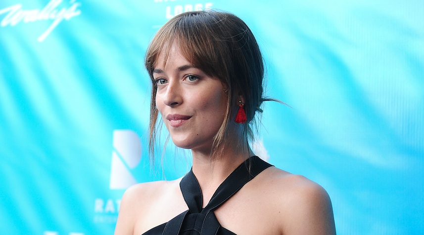"Dakota Johnson rocked a plunging neckline and braless look at the ""Fifty Shades Darker"" premiere"