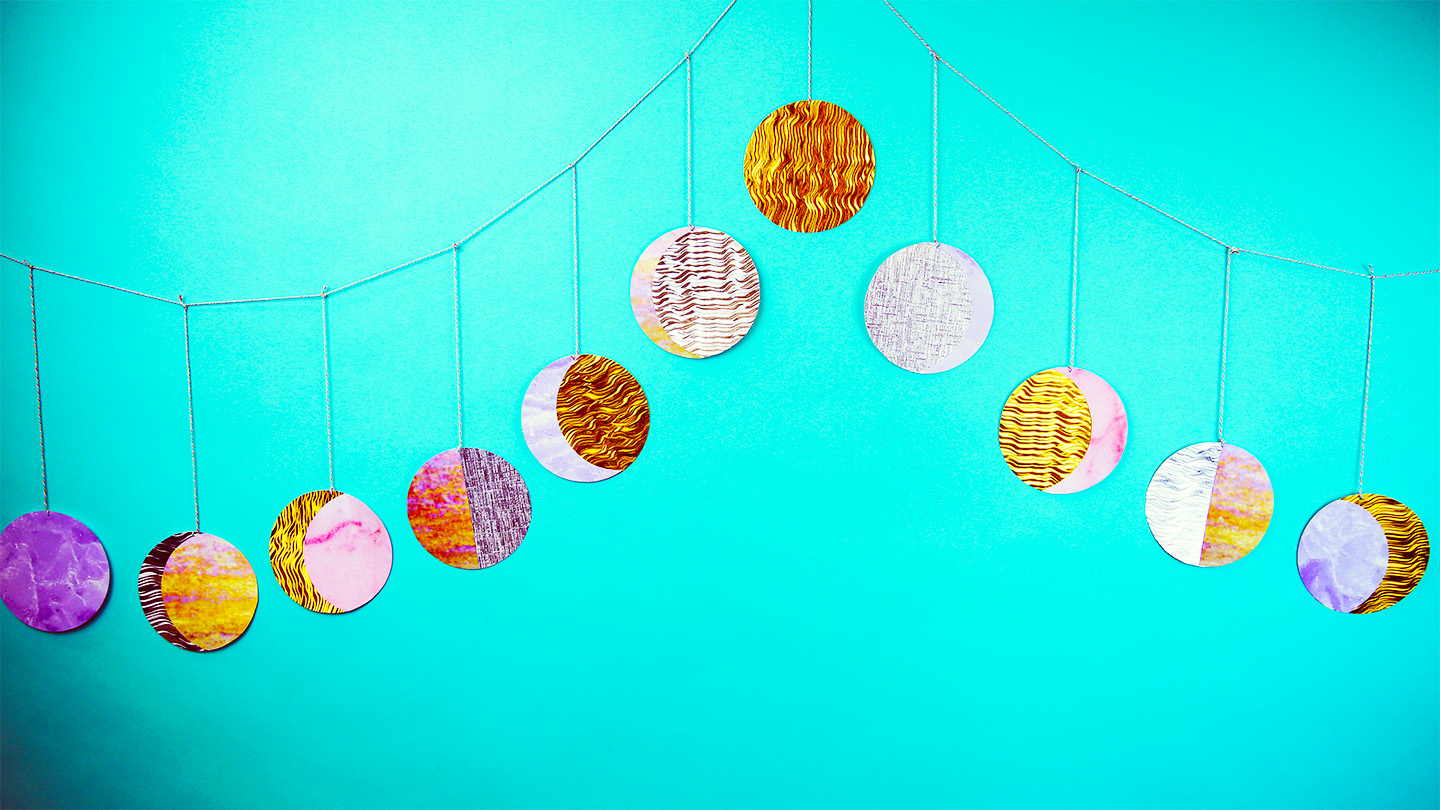 This DIY moon garland is the perfect way to turn your bedroom into a celestial haven