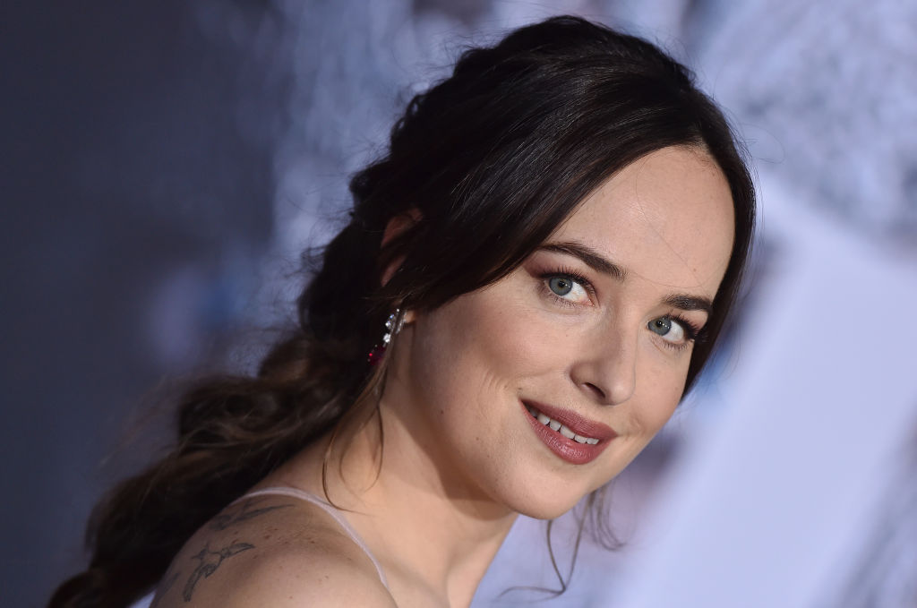 You will not recognize Dakota Johnson in her first-ever red carpet pic
