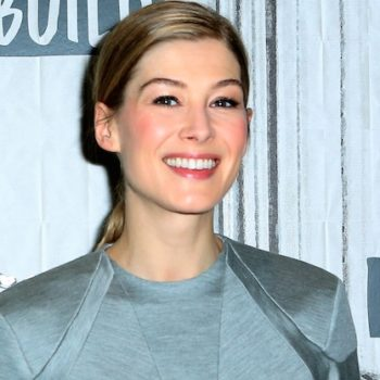Rosamund Pike's floral, '70s-inspired minidress may officially be our favorite look of the season