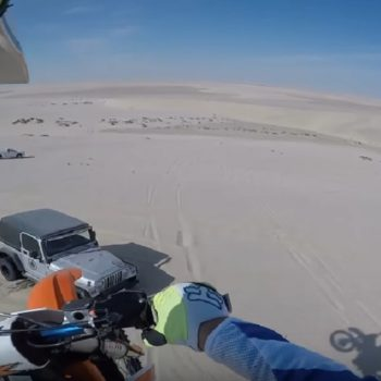 This dirt biker jumped off a 100-foot sand dune and landed on top of a Jeep
