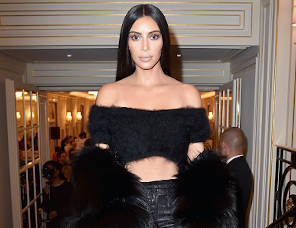 Kim Kardashian shows us the perfect way to mix textures in her suede trench and velvet tracksuit