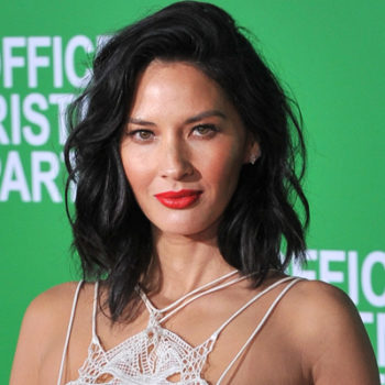 Olivia Munn's beer pong skills and sassy one-piece suit are giving us major college flashbacks