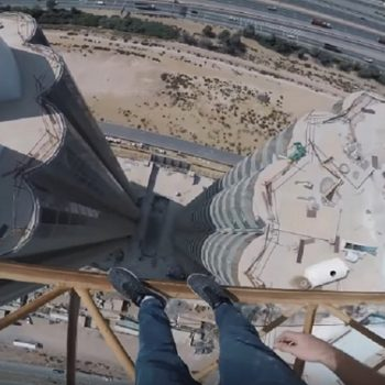 This guy walked between two cranes connected to skyscrapers, and the footage will make your toes curl