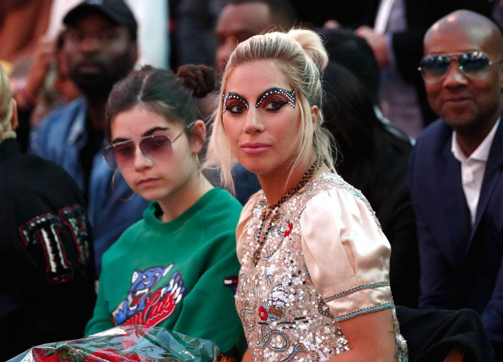 Lady Gaga took her Super Bowl makeup to new heights in the front row at Tommy Hilfiger's fashion show