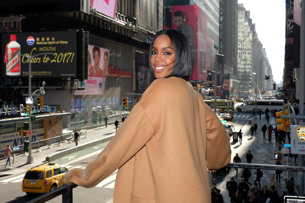 Kelly Rowland said she and Kanye West go to Fashion Week in part for the music
