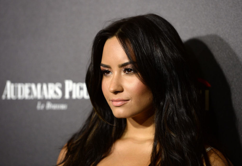 Demi Lovato's sheer lace/train/crop top combo is giving us so many goals