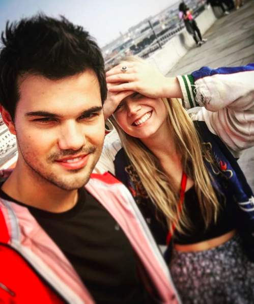 Billie Lourd wished boyfriend Taylor Lautner happy birthday with a pic of them in matching onsesies