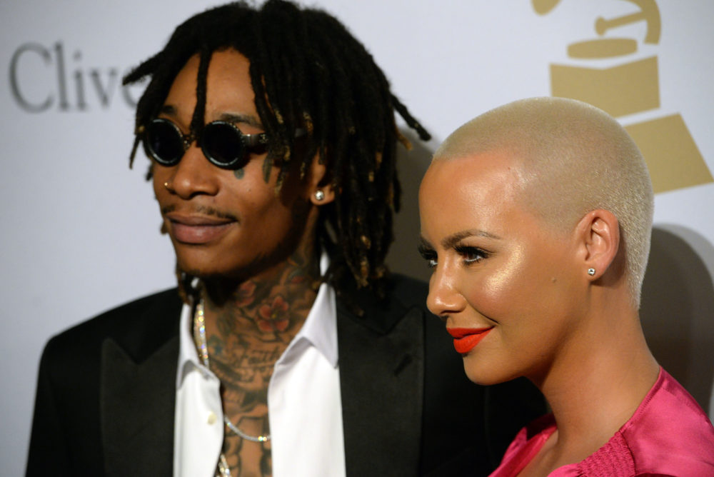 Amber Rose and Wiz Khalifa may or may not be back together, but they definitely just kissed at a Grammys party