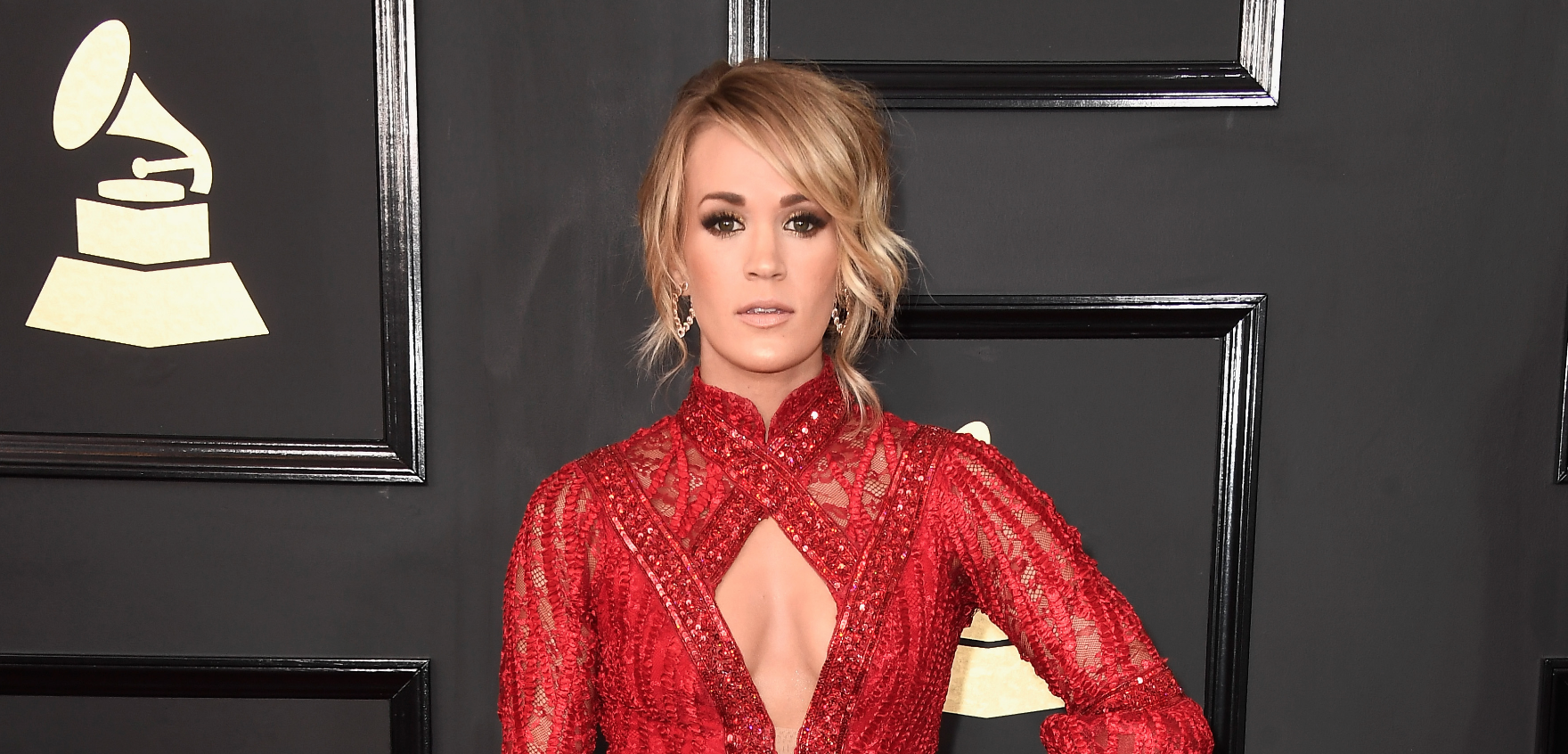 Carrie Underwood channels the dancing girl emoji in a fiery red gown at the 2017 Grammys