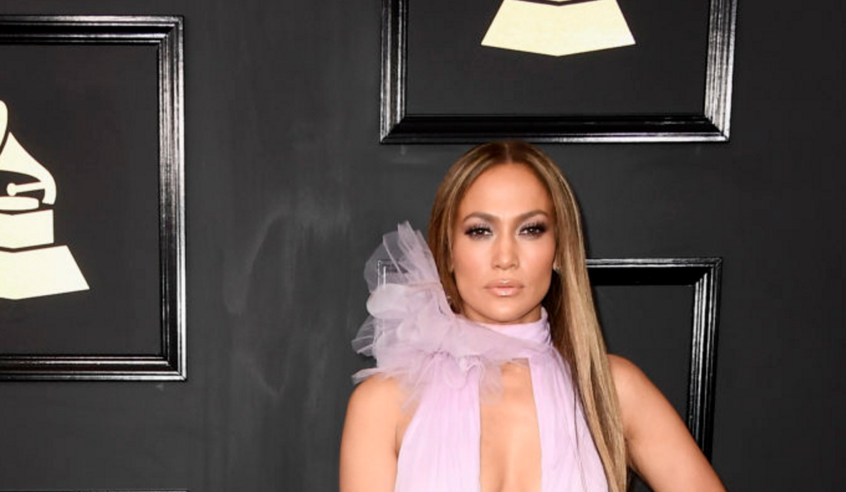 Jennifer Lopez looks like an orchid made out of icing in her deep V-cut Grammys dress
