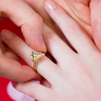 Stop everything: Domino's is giving out a pizza-shaped gold and diamond engagement ring today!