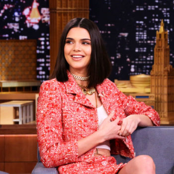 Kendall Jenner shows us how to pair a belly chain with a tweed skirt suit