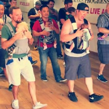 Here's a bunch of nerdy, adorable dads dancing with their babies because bonding