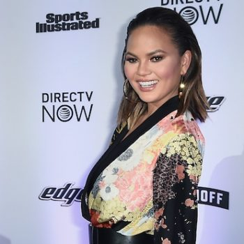 Chrissy Teigen looked beyond casual as she sat completely naked during a press day