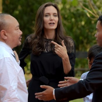 Angelina Jolie looked gorgeous in a hot pink gown in Cambodia, and we're seriously feeling this look on her
