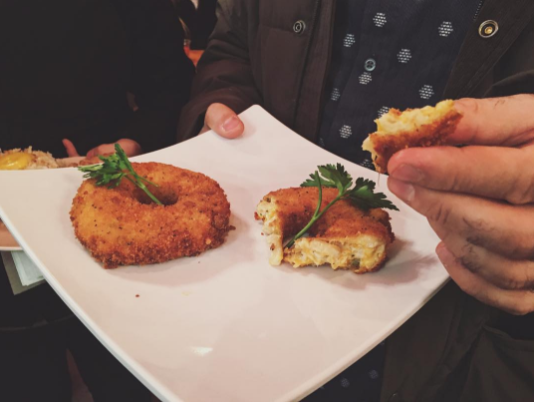 There's now a donut made of mac n' cheese and Cheetos and we're not quite sure how we feel about it
