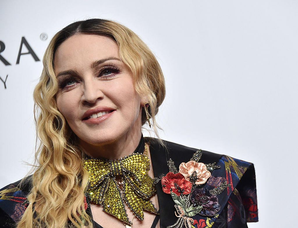 Madonna shared a pic of her newly adopted twin daughters in tracksuits, and we're getting more and more obsessed with them