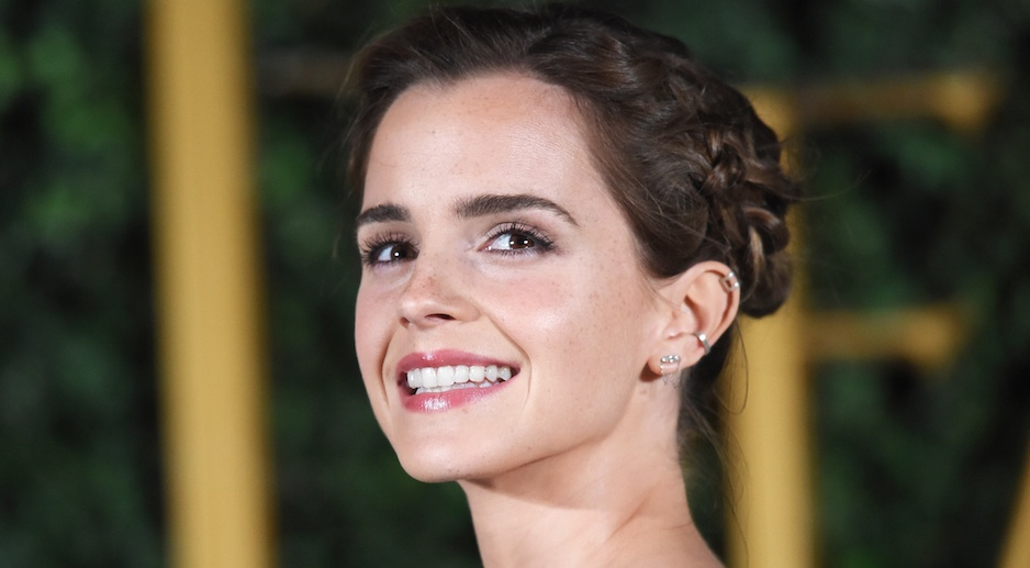 Emma Watson's asymmetrical white top looks impossible to pull off, but by gosh, she does it