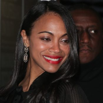 Zoe Saldana looks like she belongs at a Ren Faire in this off-white, lace-up leather dress