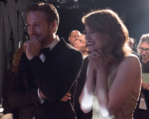 Emma Stone was having the time of her life backstage at the Oscars