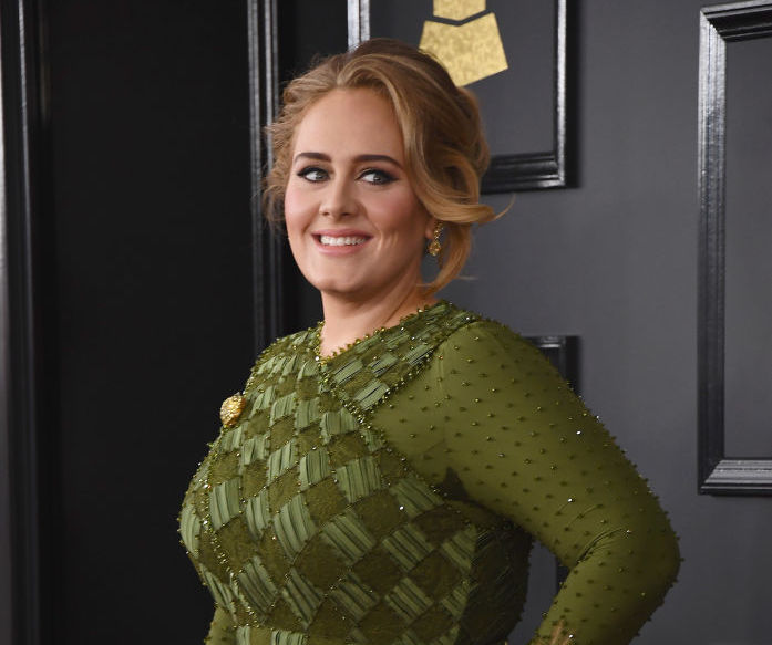 Adele was so excited for Emma Stone's win that she created her own photo op with the actress