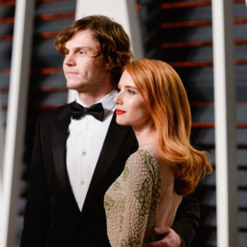 "Emma Roberts and Evan Peters have hearts passing between them at the ""Vanity Fair"" Oscar party"