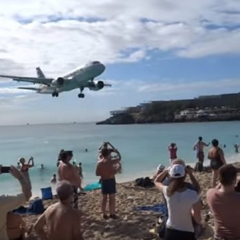 This plane landed way too close to these beachgoers, and the footage has us totally on edge