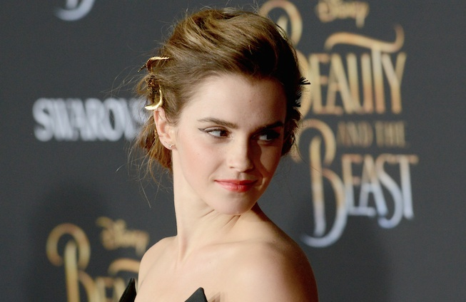 We're still trying to figure out the strap situation on Emma Watson's elegant black and ivory jumpsuit