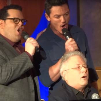 Luke Evans and Josh Gad spontaneously breaking out into song at a press conference is truly a blessing