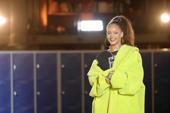 Rihanna looks more glam in just a robe than we look when we actually try
