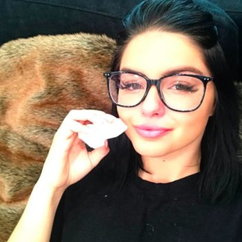 Ariel Winter mixed up a white ensemble with black, thigh-high boots, and it's genius