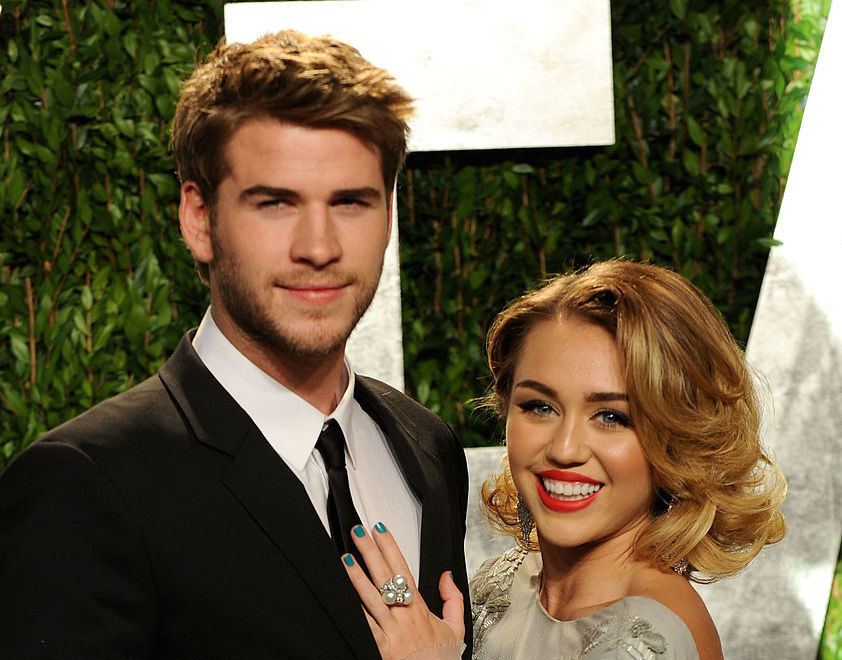 Miley Cyrus' dad has fans believing she recently married Liam Hemsworth