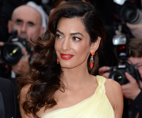 Amal Clooney has been wearing one timeless coat style in so many amazing looks