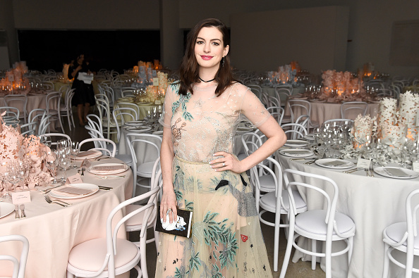 """Anne Hathaway pulls off a vintage undergarment look on the cover of """"Elle"""""""