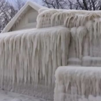 Here's a house completely covered in ice, because winter isn't quite done with us yet