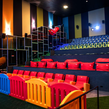 This movie theater has a jungle gym inside for kids, which is a genius idea that's way overdue