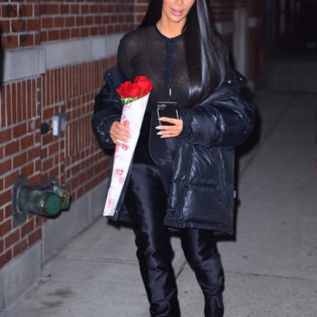 We almost missed Kim Kardashian and Rihanna twinning in these sexy, waist-high $4,590 boots
