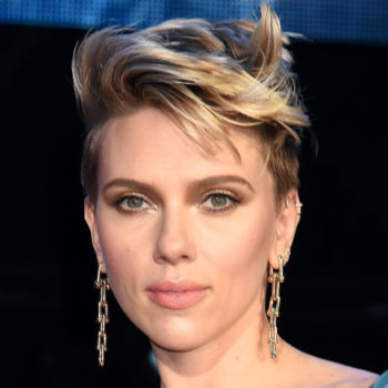 Scarlett Johansson's asymmetrical teal jumpsuit makes us rethink how to wear draped satin