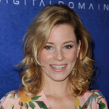 Elizabeth Banks is bringing back giant '80s shoulders, and somehow she's making it work