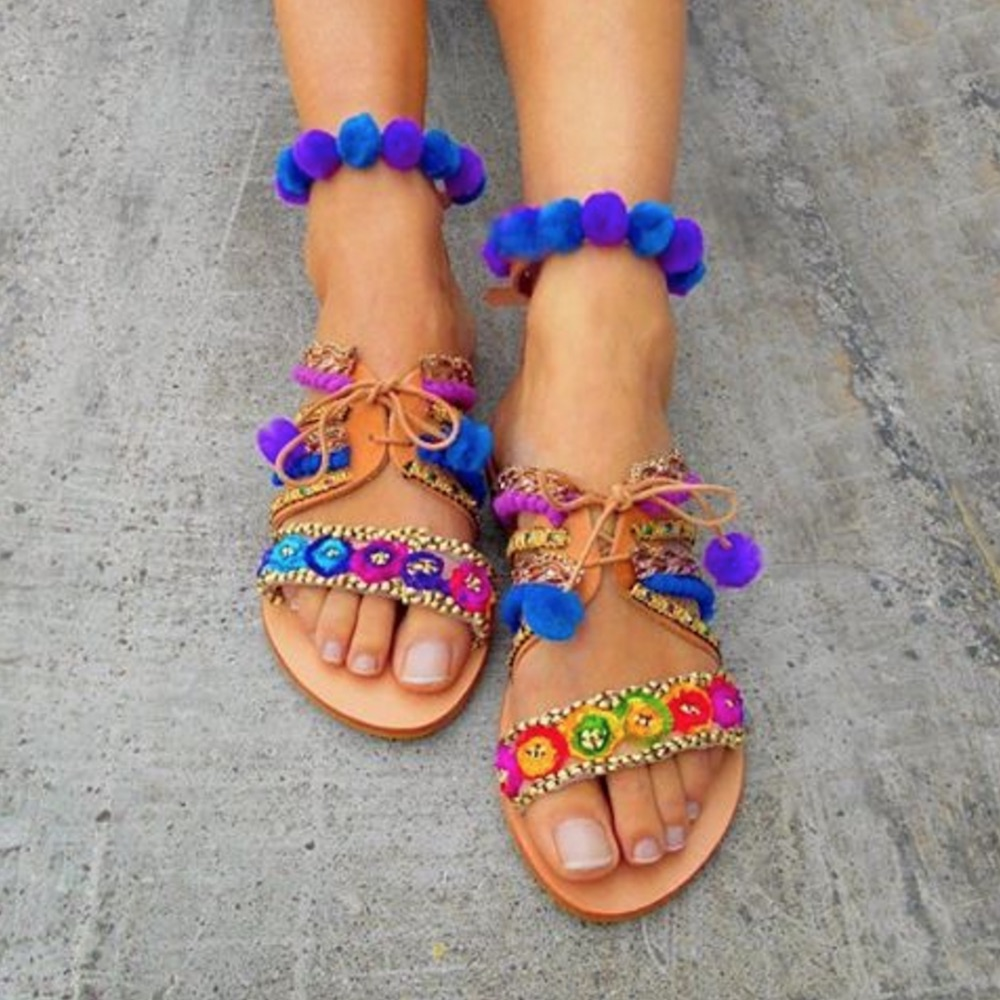 Here are 18 pom pom sandals to give your spring wardrobe a burst of color