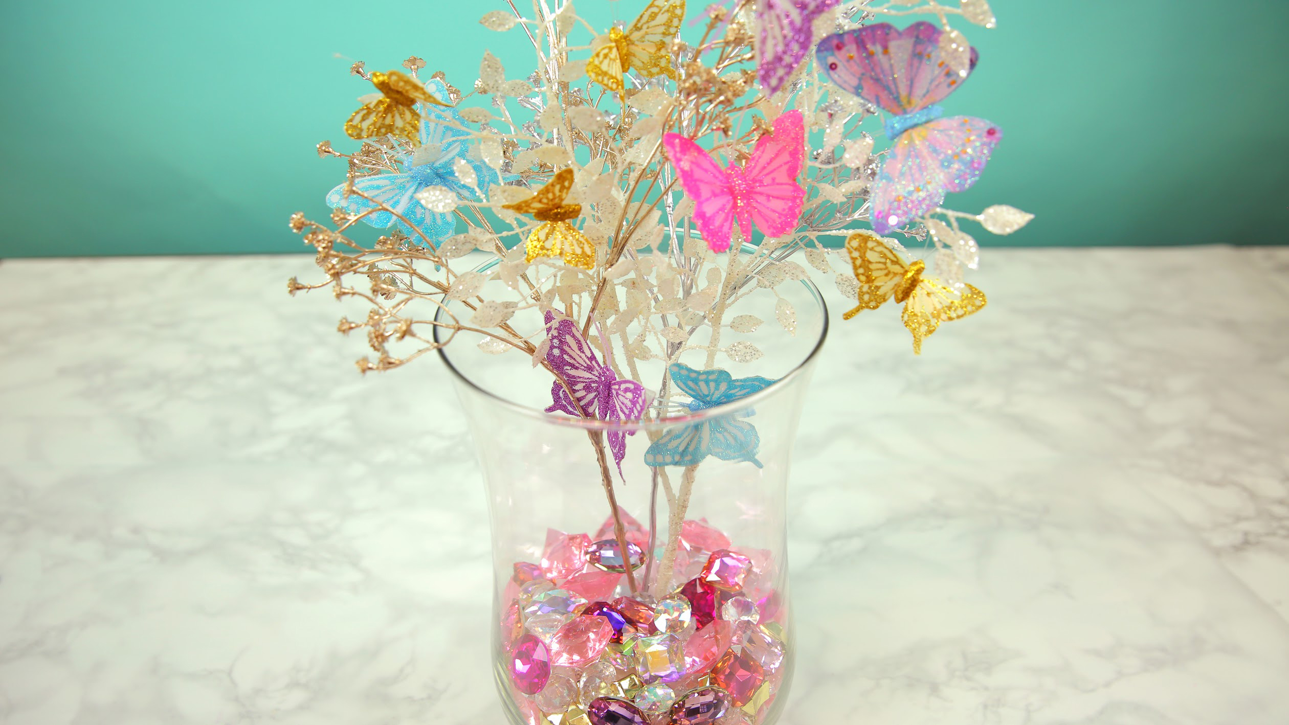 This glam butterfly centerpiece will turn any room in your house into a ~sparkle den~