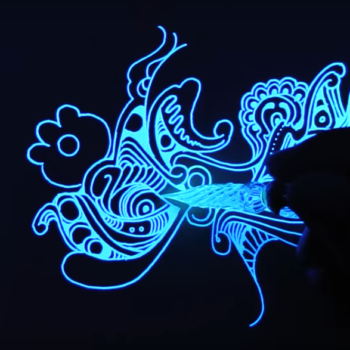 We are completely mesmerized by these glow-in-the-dark drawings