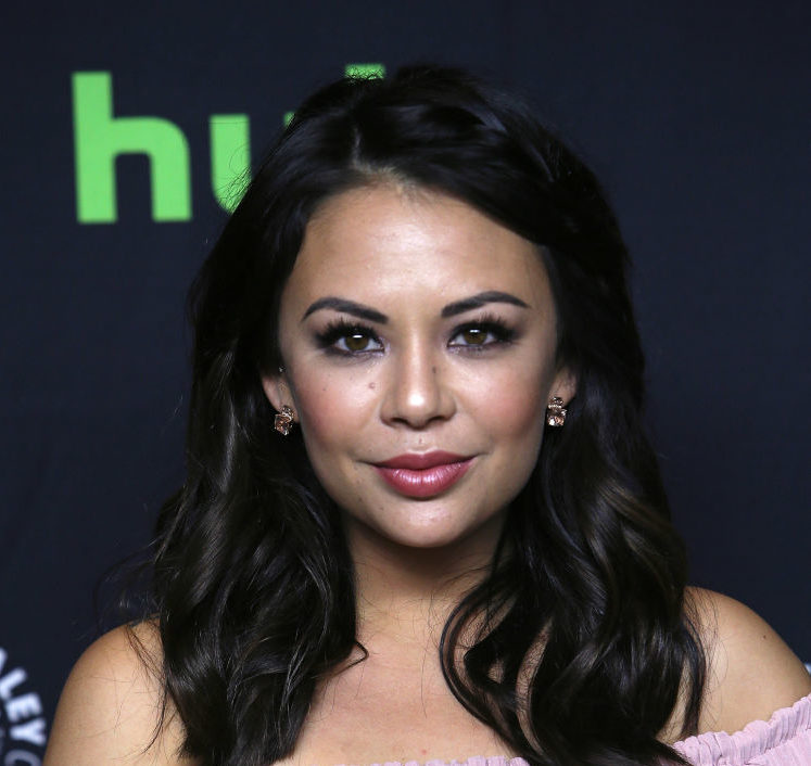 "Janel Parrish is cupcake chic in her blush playsuit during the ""Pretty Little Liars"" Paleyfest Panel"